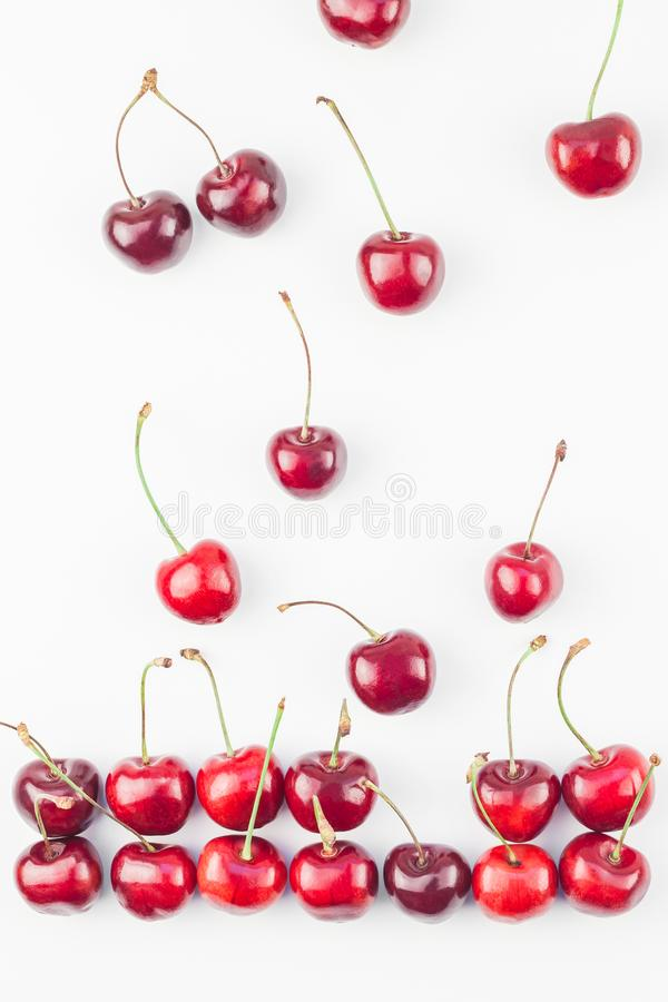 Fresh ripe cherry pattern isolated. Creative top view of fresh ripe cherry pattern layout with copy space isolated on white background in minimal style. Concept stock photos
