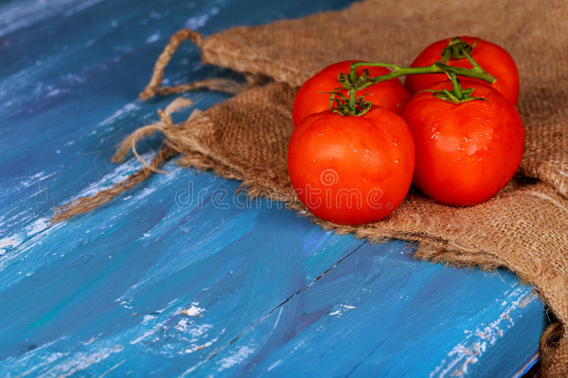 fresh, ripe cherry tomatoes on wood royalty free stock images
