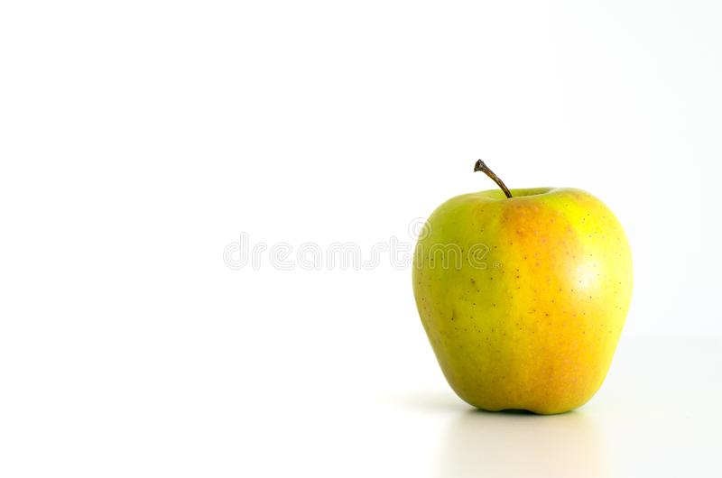 Fresh ripe coloured apple. Isolated against bright white backdrop stock photos