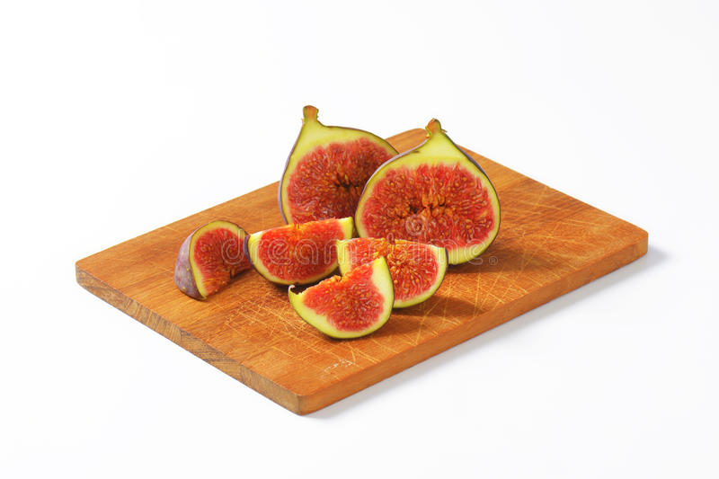 Fresh ripe figs. Fresh figs cut into halves and wedges stock images