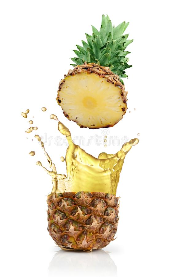 Fresh ripe flying cut pineapple with juice splash for healthy nutrition. Isolated on white background royalty free stock photography