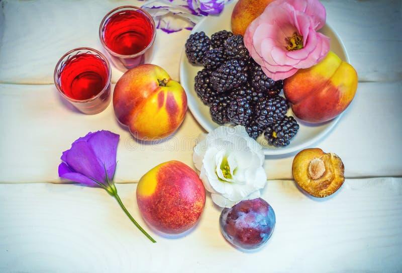 Fresh ripe fruits, berries and homemade liquor royalty free stock photo