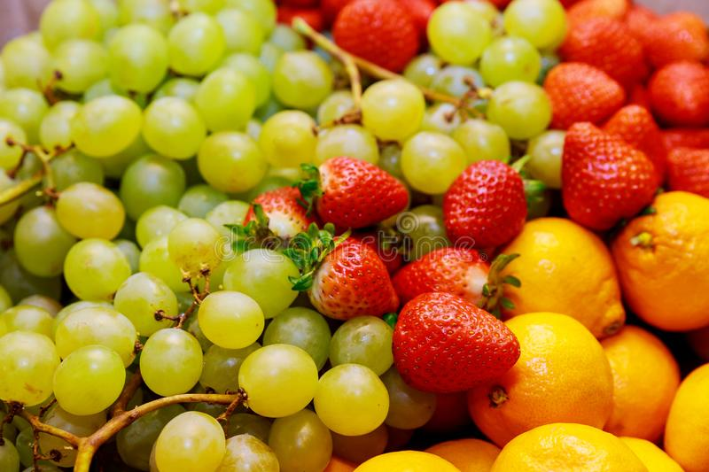 Fresh ripe fruits, grapes, strawberry, tangerines. Close up stock images