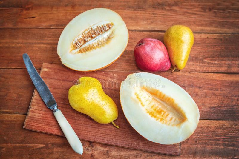 Fresh ripe juicy melon and plums stock photography