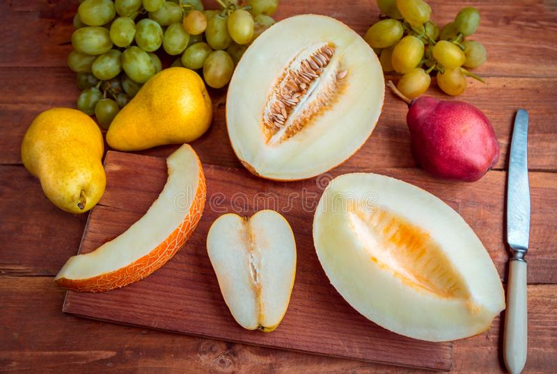 Fresh ripe fruits on the table royalty free stock images