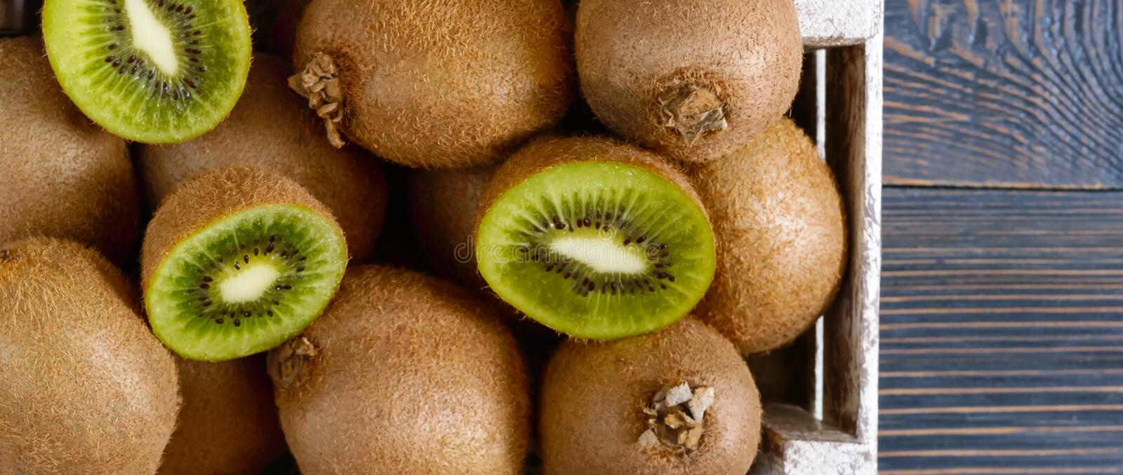 Fresh ripe kiwi fruit in a wooden box on the table. Tropical Fruit. Healthy food. stock images