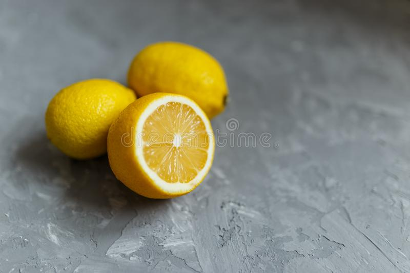 Fresh ripe lemon against a dark background. side view with copy space royalty free stock photo