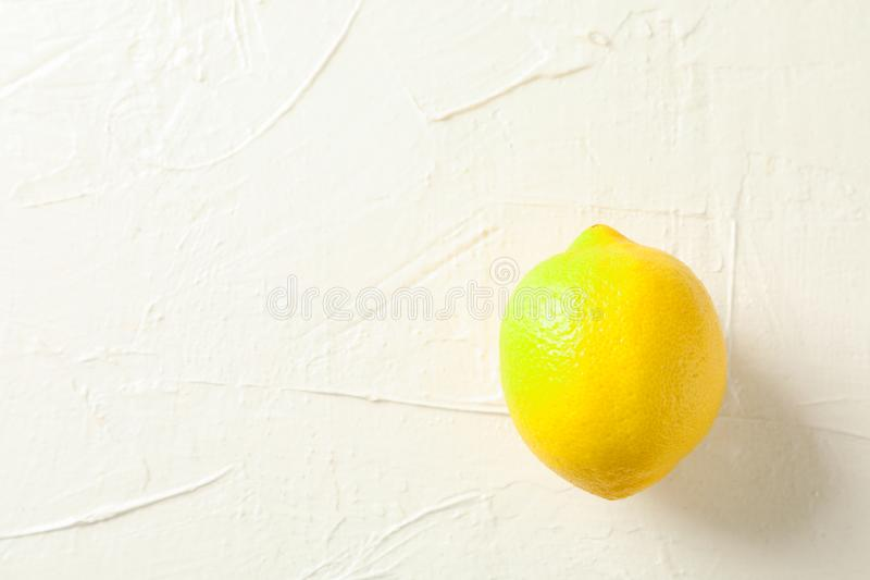 Fresh ripe lemon on white background. Space for text royalty free stock photography