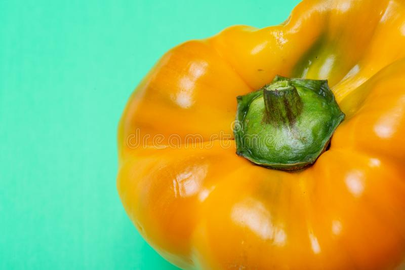Fresh Ripe Organic Bell Peppers, a cultivar group of the species Capsicum annuum, isolated on green. Background royalty free stock image