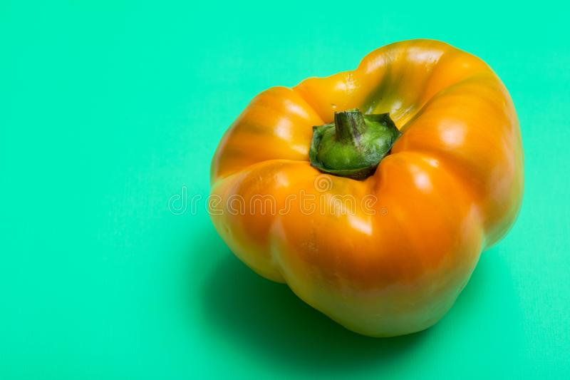 Fresh Ripe Organic Bell Peppers, a cultivar group of the species Capsicum annuum, isolated on green. Background stock images