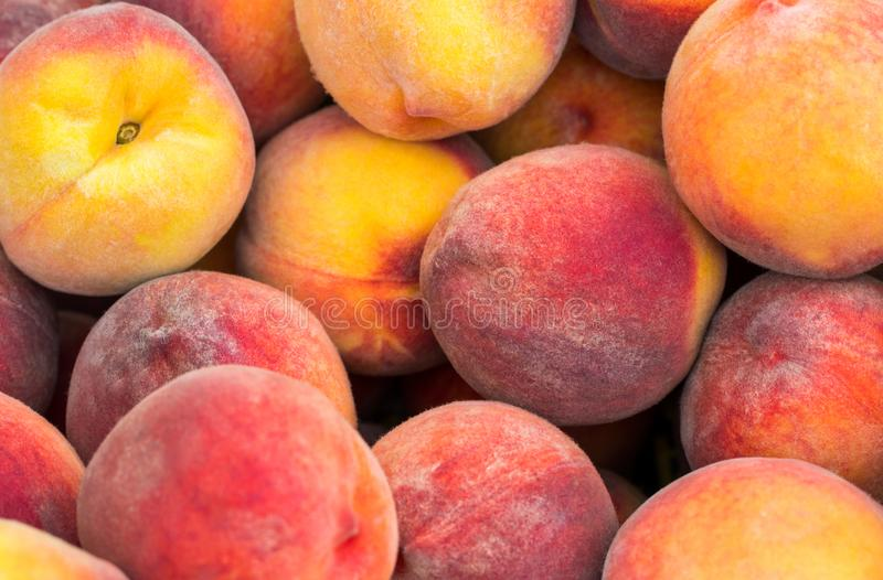 Fresh ripe peaches in the box ready for sale royalty free stock photo