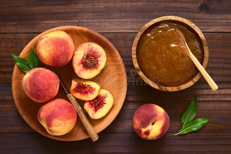 Fresh Ripe Peaches and Peach Jam stock photo