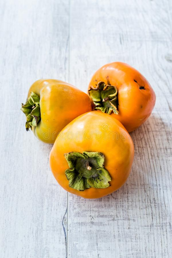 Fresh Ripe Persimmon Fruits Ready to Eat stock photography