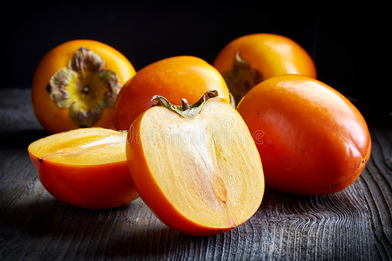 Fresh ripe persimmons royalty free stock photo
