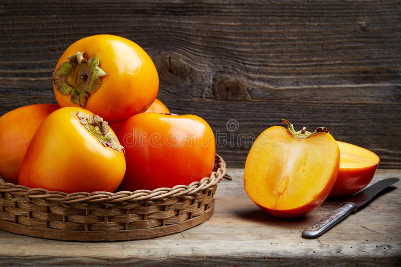 Fresh ripe persimmons royalty free stock photos