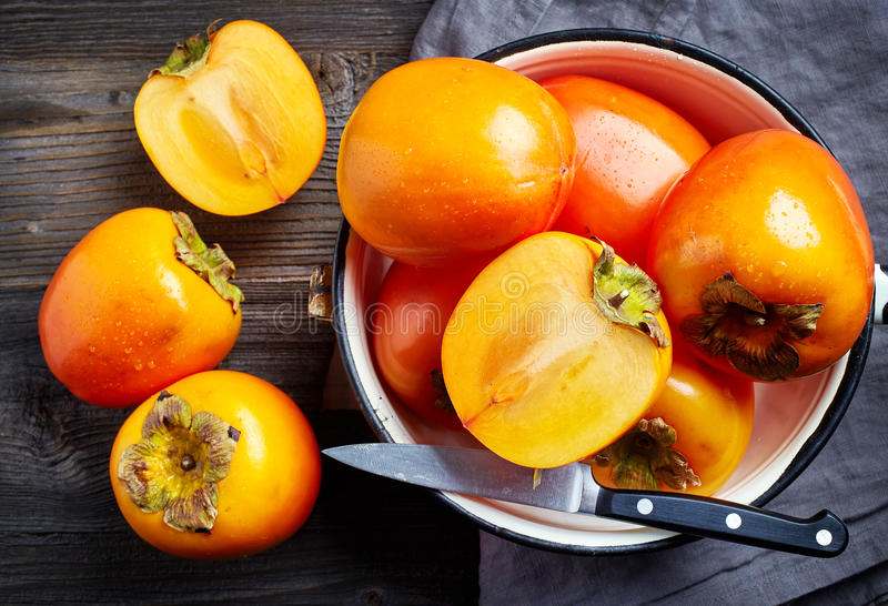 Fresh ripe persimmons royalty free stock images