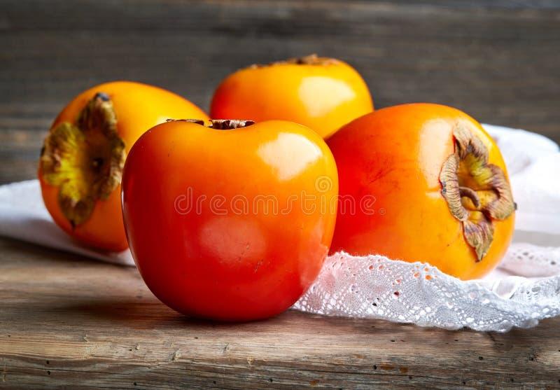 Fresh ripe persimmons stock image