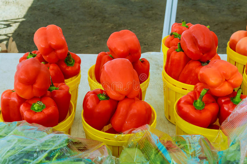 Fresh ripe red sweet bell pepper in box on sale at grocery food store. royalty free stock images