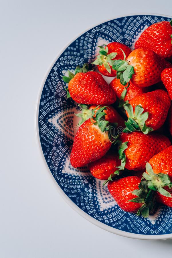Fresh ripe strawberries in a blue and white plate royalty free stock photos