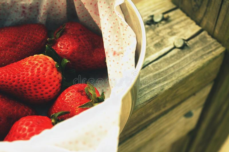 Fresh ripe strawberries in a silver bowl royalty free stock photos