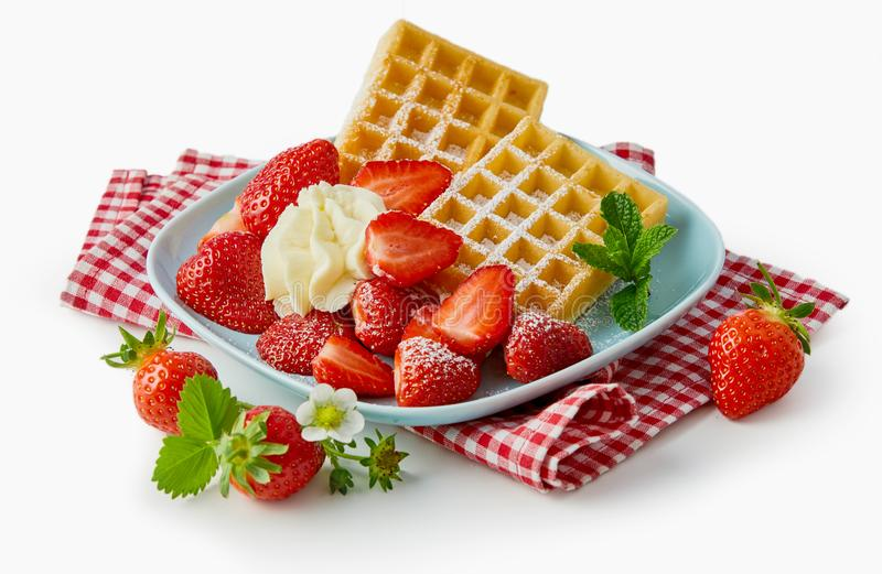 Fresh ripe strawberries with waffles and cream stock images