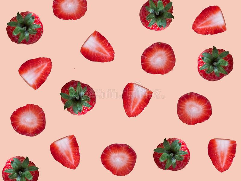 Fresh ripe strawberry pattern isolated on light pink background. royalty free stock image