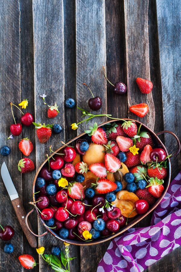 Fresh ripe summer berries and fruits stock photography