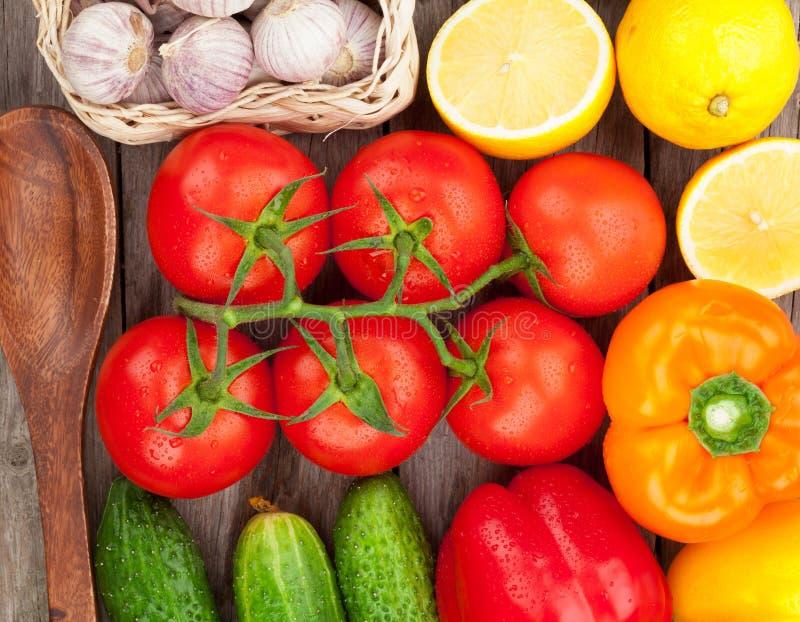 Fresh ripe vegetables closeup. Fresh ripe vegetables on wooden table stock photo