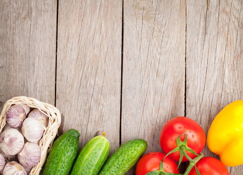 Fresh ripe vegetables on wooden table royalty free stock photography