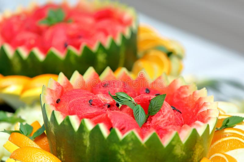 Fresh ripe watermelon in a hollow shell on the party stock photo