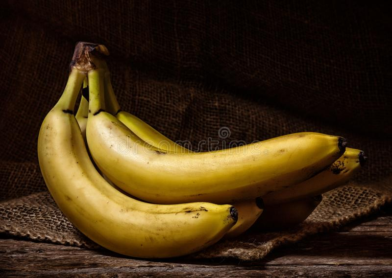 Yellow Bananas on a Wood Table royalty free stock photos