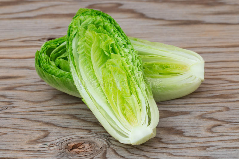 Fresh romaine lettuce. Fresh romaine lettuce on wooden table stock images