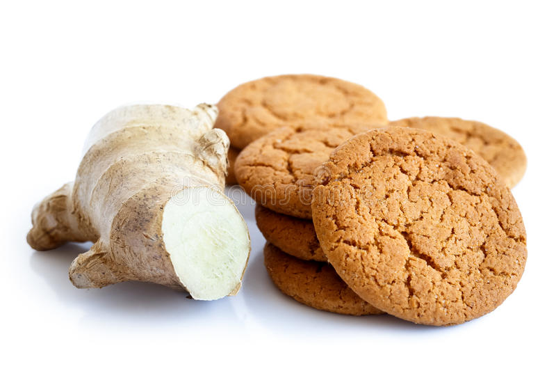 Fresh root ginger with ginger biscuits. stock photography