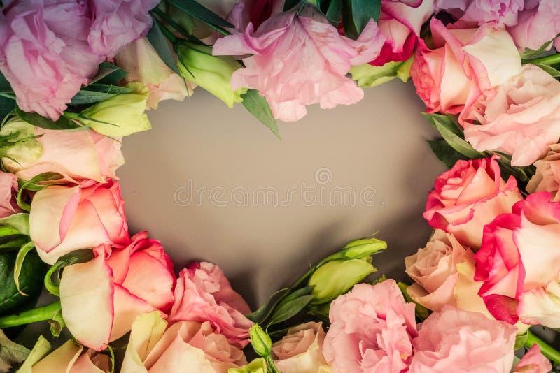 Fresh rose flowers on gray stock photo