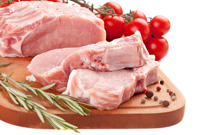 Fresh Row Pork  With Rosemary And Spices On Wood Board Royalty Free Stock Image