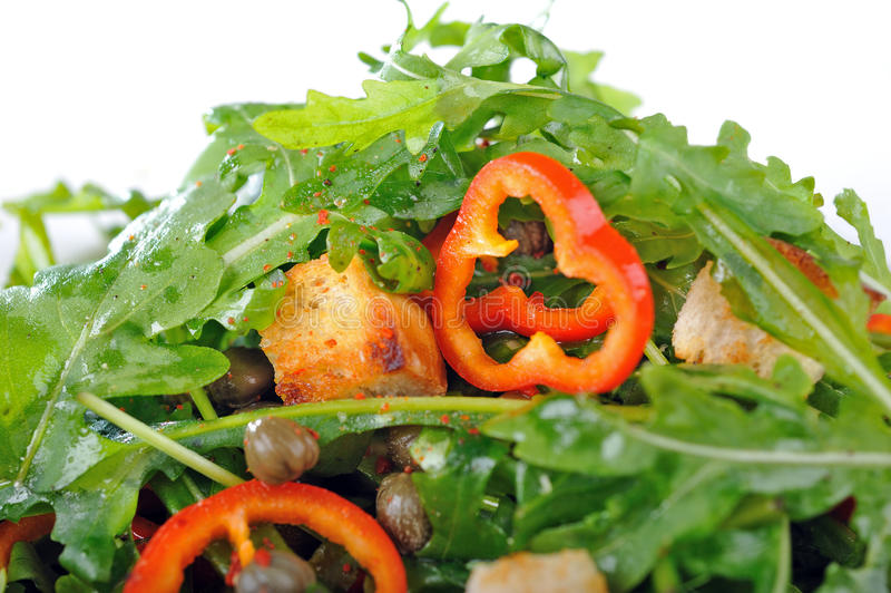 Fresh rucola salad. With paprika and capers and roasted bread stock images