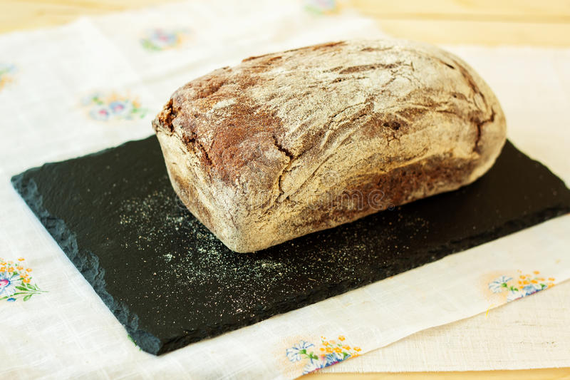 Fresh rye bread on slate plate. Selective focus royalty free stock photography