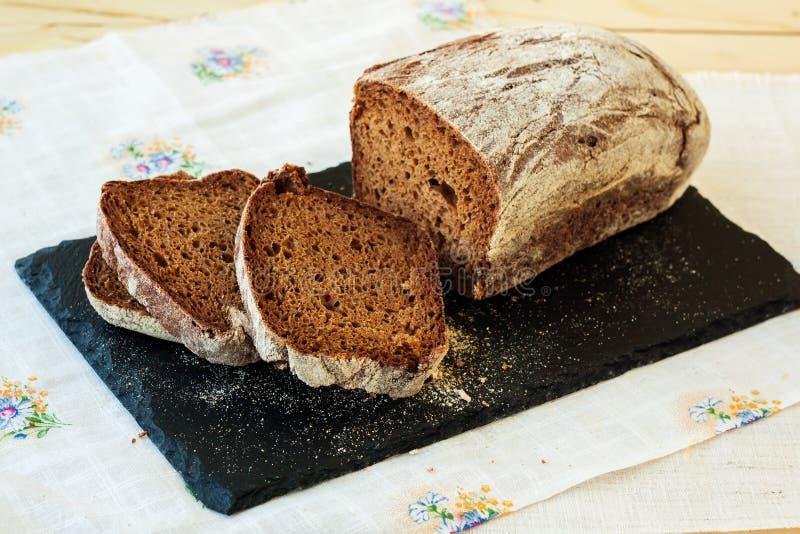 Fresh rye bread on slate plate. Selective focus stock image
