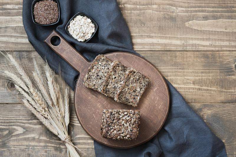 Fresh rye bread on wooden table. Top view. Copy space. Fitness whole grain bread royalty free stock images
