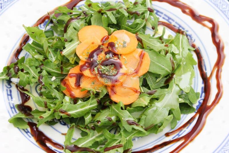 Fresh salad. A fresh salad of rucola and carrots royalty free stock photo