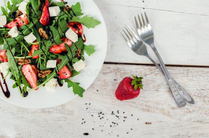 Fresh salad with arugula and strawberries stock photo