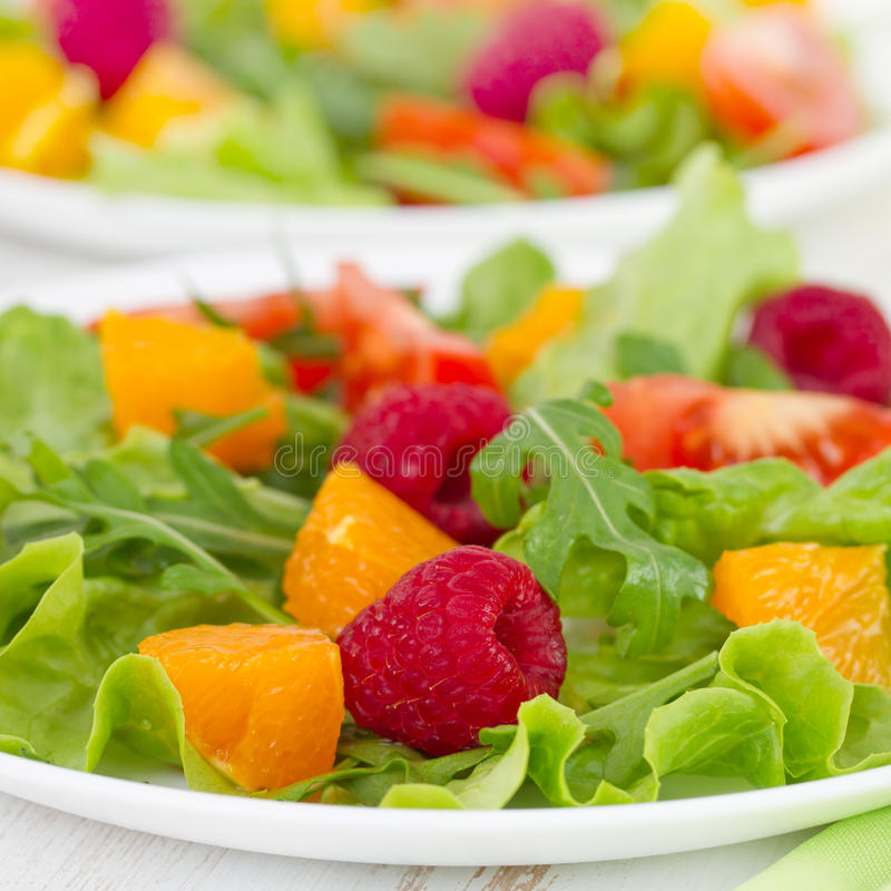 Fresh salad with berries. Fresh salad with raspberries and orange royalty free stock photography