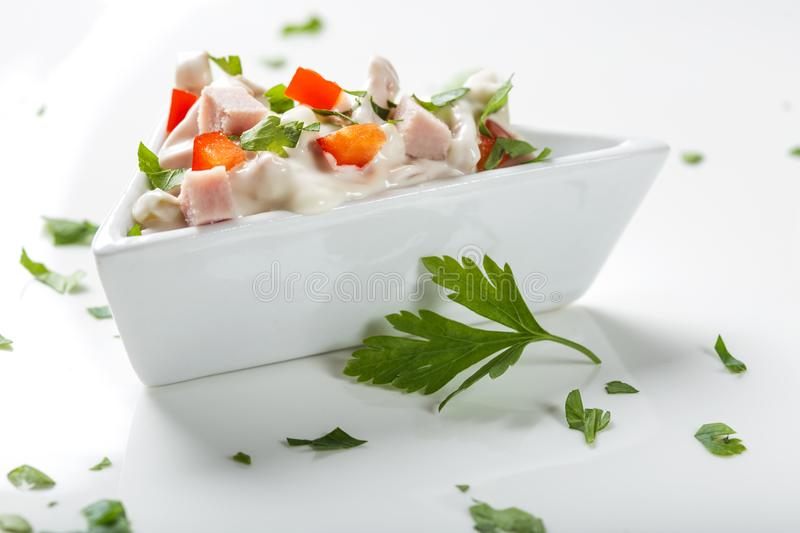 Fresh salad in bowl made from meat, red pepper and mayonnaise royalty free stock photos