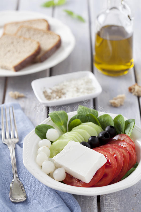 Fresh salad and bread royalty free stock photos