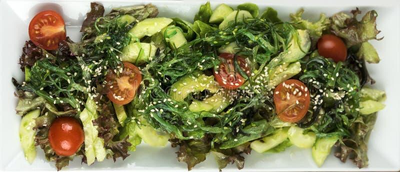 Fresh salad with cherry tomatoes, avocado royalty free stock photos