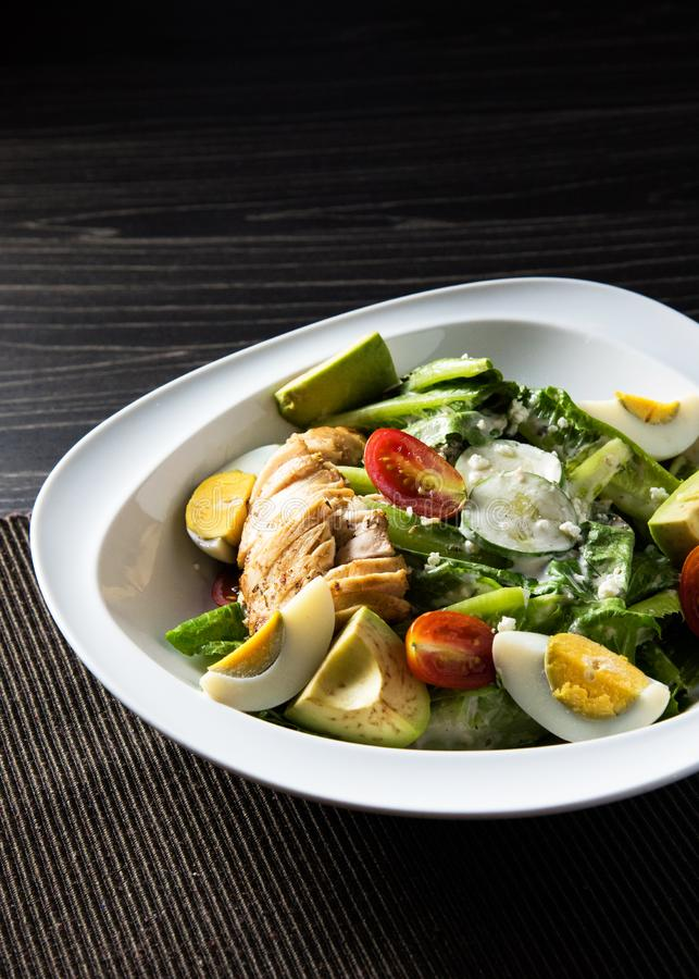 Fresh salad chicken breast with arugula and cherry tomatoes royalty free stock photo