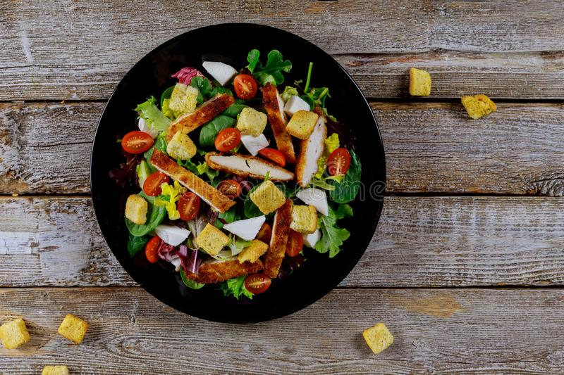 Fresh salad with chicken breast, arugula and tomato. Top view stock photography