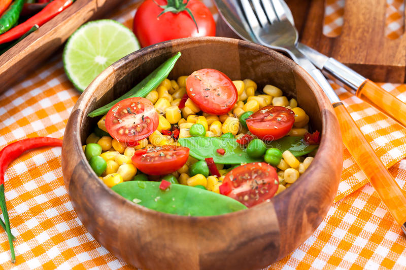 Fresh salad with corn, peas, tomato and chilli. Fresh salad with sweet corn, green peas, tomato and chilli pepper stock image