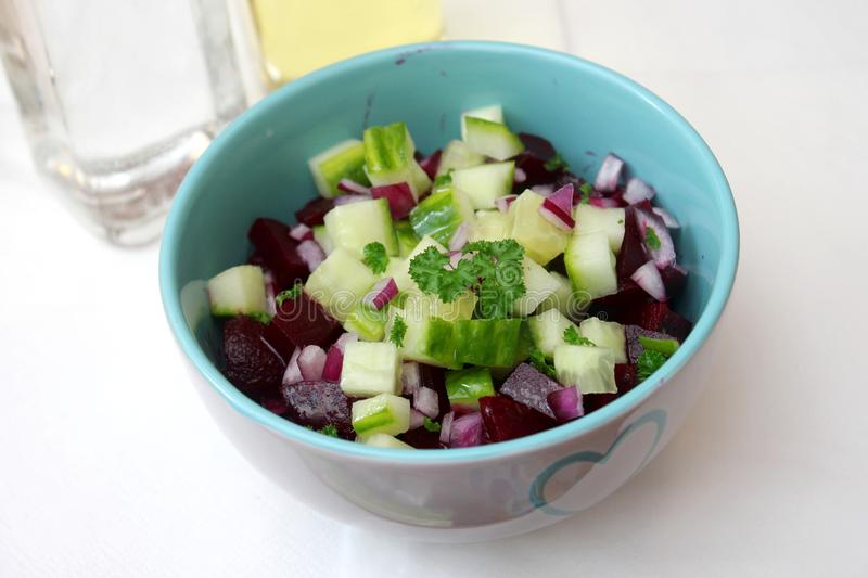 Salad of beet roots with cucumber. A fresh salad of cucumber and red beet roots stock photography