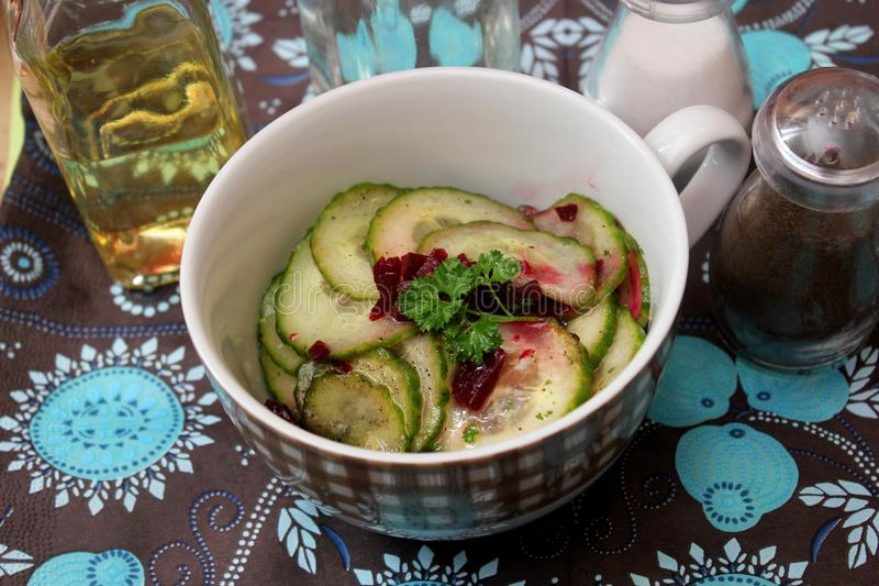 Salad of cucumber and beet roots. A fresh salad of cucumber and red beet roots royalty free stock images